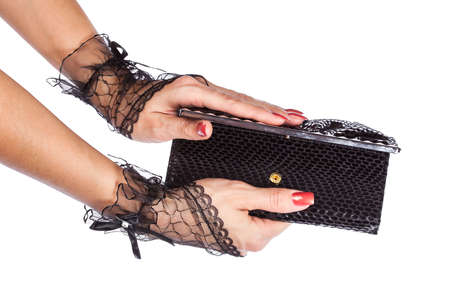 Woman hand in black lace gloves with purse, isolated on white photo
