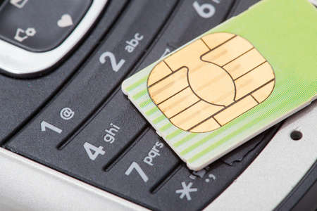 Close up of cell phone and sim card Imagens