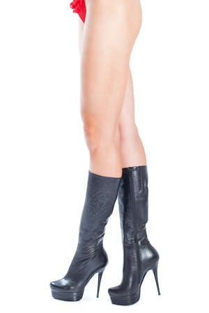 jackboots: sexy woman legs in black shoes isolated on white