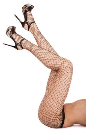 Sexy Frauen Beine in Netzstrümpfen isoliert über weiß Standard-Bild - 26184131
