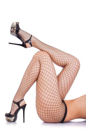 Sexy Frauen Beine in Netzstrümpfen isoliert über weiß Standard-Bild - 28167351