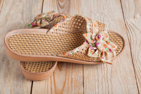 slippers on wooden borad photo