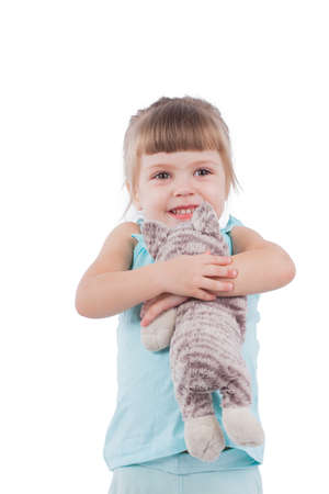 Little girl with a toy cat isolated