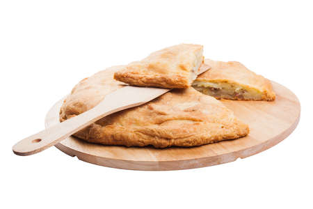 meat pie on a wooden board.  Isolated. Stock Photo