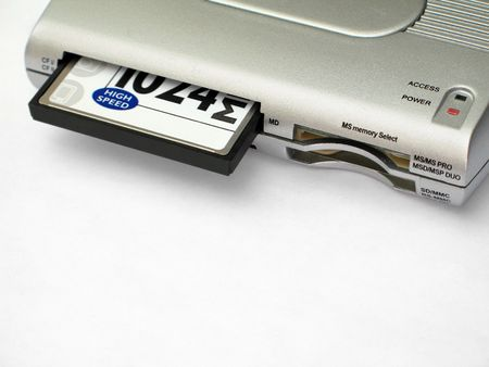 A multiple-type memory card reader with a Compact Flash card inserted