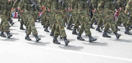 Soldiers marching in an army parade photo