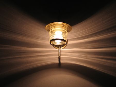 An interior lamp fastened on the wall, and the patterns the light creates Stock Photo
