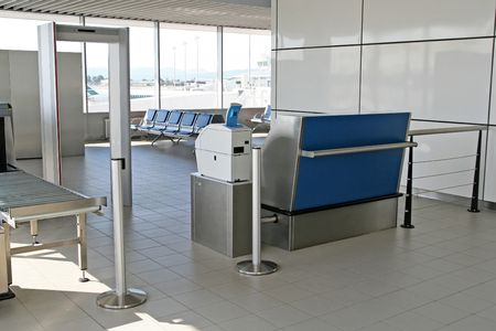 airport security: The waiting area - behind the security entrance and desk - of an airport terminal
