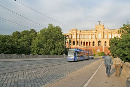 streetcar: A streetcar (and a couple) on the bridge of river Isar, and under the Maximilianeum (Munich, Germany)