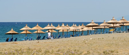 aegean: A beach with beach umbrellas and chairs at Agiokampos, area of Larissa, Greece