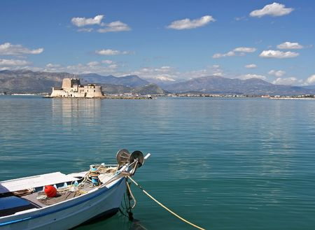 bourtzi: The castle island of Bourtzi, in Nafplio (Greece) with a boat in the foreground