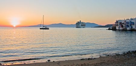 mediterranean houses: Mykonos town, a cruise ship, a and yacht during sunset (Greece)