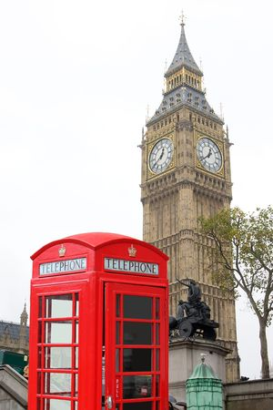 Two typical icon of London, UK, the Big Ben, and a red telephone booth; this is a combination of two separate images Stock Photo