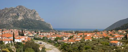 arkadia: A panoramic view (made of two stitched photos) of the historical town of Leonidio, in Peloponnese, Greece