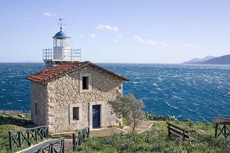arkadia: The lighthouse in the area of Astros, Peloponnese, Greece, overlooking the Aegean sea