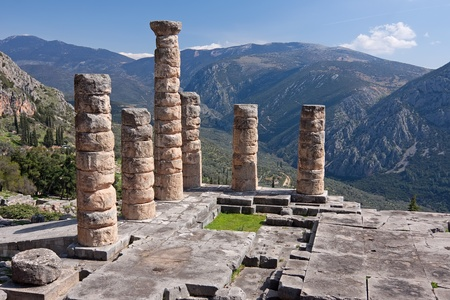 The ruins of Temple of Apollo in the archaeological site of Delphi in Greece; Delphi was believed to be the centre of the earth Stock Photo