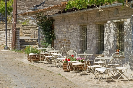 A patio of a coffee shop in the little village of Papigo, Greece