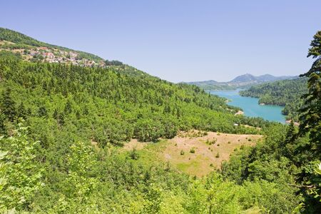 thessaly: A view to a fjord of Plastiras Lake and the village of Mpelakomitis, Thessaly, central Greece