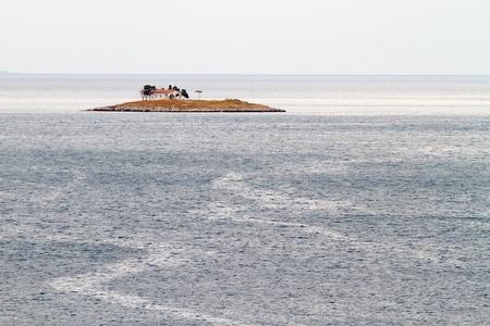 islet: The little islet of Agios Konstantinos, with the little church on it, near Itea, Fokida area, Greece