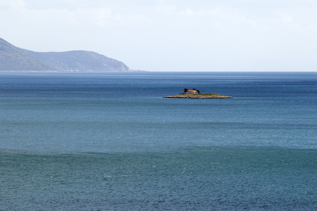 minuscule: A minuscule island, with a little church on it, near Itea, central Greece Stock Photo