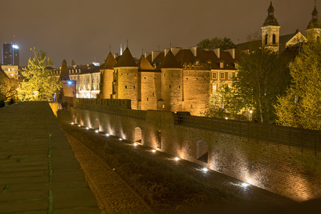 A night view of a part of the fortification of the old town of Warsaw, Poland, including the Barbican Editorial