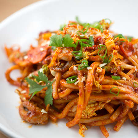 Spicy baby octopus stir fry with udon noodles