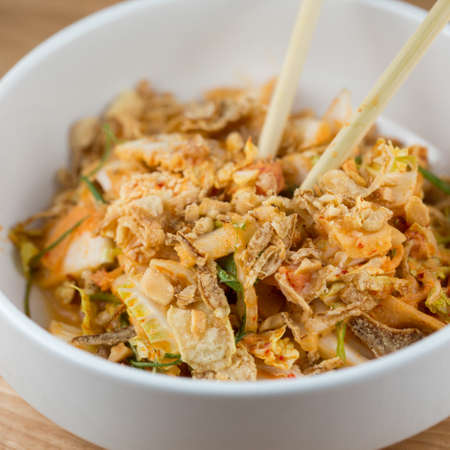 Sweet & Sour.  Creamy Kimchi Dressing, Nappa Cabbage, Pickled Melon and Cashew Stock Photo