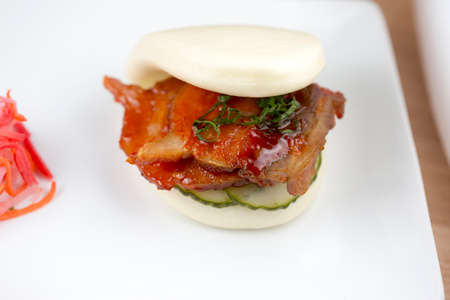 hoisin: Sweet Chili Pork Belly Steam Bun Stock Photo