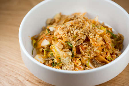 nappa: Sweet & Sour.  Creamy Kimchi Dressing, Nappa Cabbage, Pickled Melon and Cashew Stock Photo