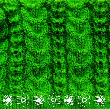 blue green background: Knitted woolen texture braids blue with snow crystal