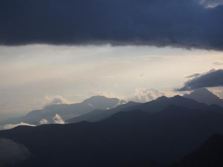 haze: blue mountain ranges in the haze. clouds. caucasus