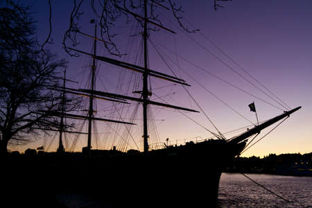 corsair: Silhouette of sailing vessel  in night sky. Stock Photo