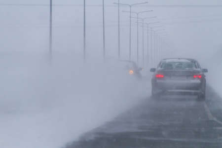 drivers: Winter Traffic, low visibility, blizzard and twilight Stock Photo