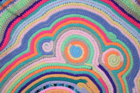 knitted colored structure with round elements Stock Photo