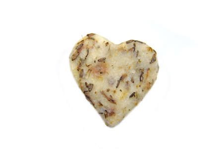 heart-shaped soap with herbs