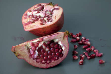 A pomegranate split open to display its red juicy seeds