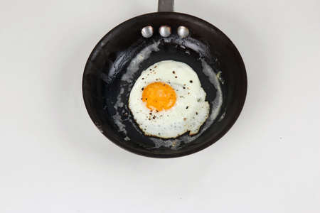 Fried Egg with Cracked Pepper and Salt Stock Photo