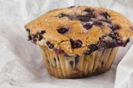 A trio of freshly baked blueberry muffins stacked on top of each other Stock Photo