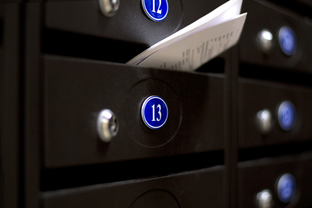 Mailboxes in an apartment house. The letter in the mailbox