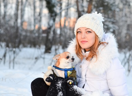 Attractive young woman in wintertime outdoor. Winter forest.