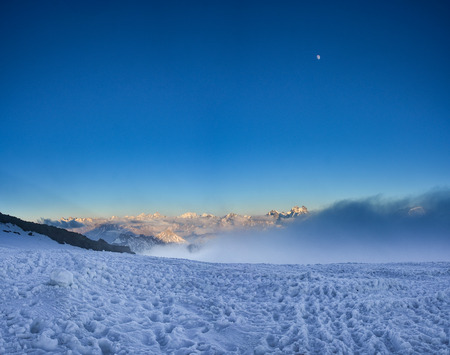 A beautiful mountain landscape. Evening view of the North Caucasian ridge from Mount Elbrus.