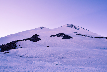 A beautiful mountain landscape. The highest peak of Europe is Mount Elbrus in the sunset. Stock Photo
