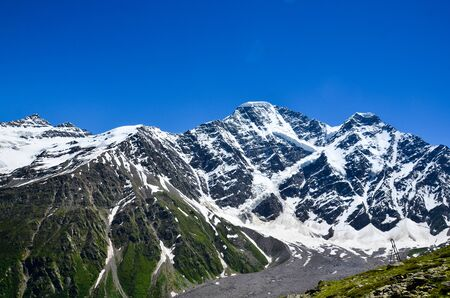 A beautiful mountain landscape. View of the Donguz-Orun mountain from Mount Cheget. Russia. Stock Photo