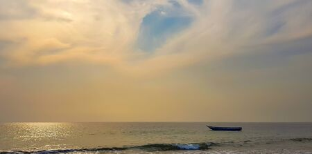 Boat in the ocean against the backdrop of a beautiful sunset. Atlantic coast. Af