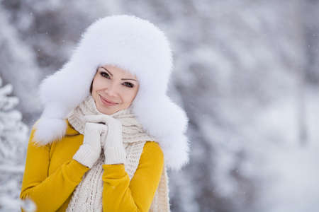 Young woman winter portrait in snowy park  Outdoors  photo