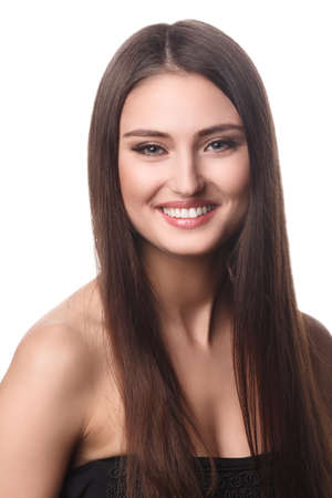 Beautiful woman with long brown hair  Closeup portrait of a fashion model posing at studio  photo