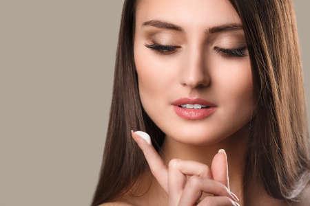 Beautiful woman with long brown hair  Closeup portrait of a fashion model posing at studio  photo