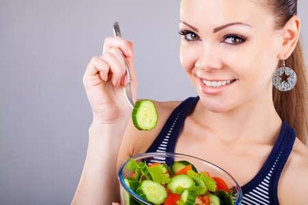 happy healthy woman with salad photo