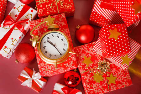 minute: Christmas  big red gift box with red alarm clock - last minute christmas shopping