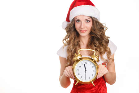 young happy smile woman wear santa clause costume, attractive christmas new year party girl looking at camera hold clock, isolated over white background photo